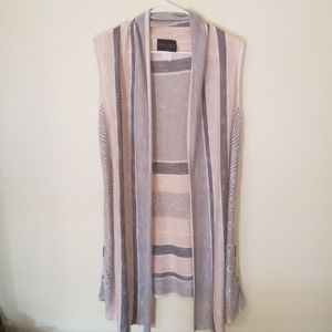 Pink and gray sleeveless cardigan.